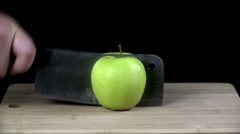 Green apple chopped up in half with a cleaver Stock Footage