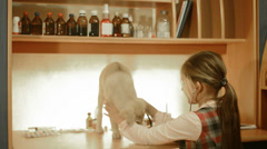 little girl playing in the vet - stock footage
