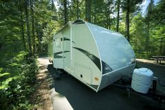 travel trailer in rv park. recreation vehicle - stock photo