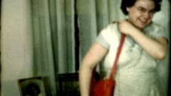 Female models a red purse 1940s fashion vintage film historic Stock Footage