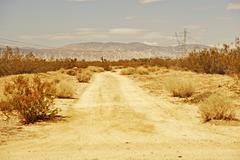 Mojave desert road to wind turbines Stock Photos