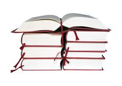 Open book on a stack of books - stock photo