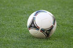Close-up official uefa euro 2012 ball on the grass Stock Photos