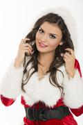 Flirtatious santa girl Stock Photos