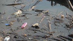 A large amount of trash polluting our waters - stock footage