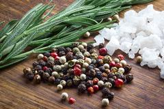 Pepper, salt and rosemary Stock Photos