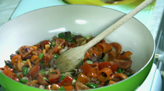 Adding the tomato souce into the vegetable mix in the pan Stock Footage