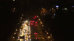 Cars in traffic, night rush hour, boulevard, lights, zoom out Stock Footage