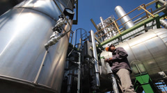 A man working in petrochemical plant - stock footage