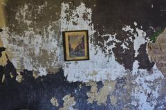 Lone picture in an abandoned slum building Stock Photos