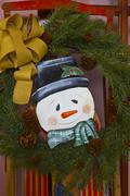 Stock Photo of christmas snowman with wreath and ribbon