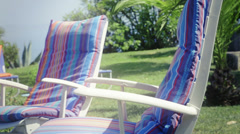 Chairs in green garden Stock Footage