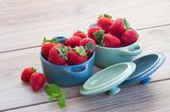 Stock Photo of bowls with strawberry on a table