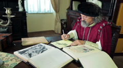 Old expert during writing his new ideas dressed in medival clothes Stock Footage
