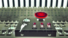 Launch button on a control console Stock Footage