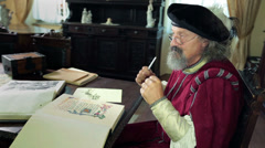 An old medieval scholar talking about his newest findings  Stock Footage