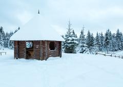 Wooden summerhouse on winter hill top. Stock Photos