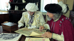 Close shot of two medieval men talking about old map Stock Footage
