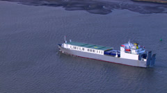 Aerial view of a container ship sailing down the River Thames in London Stock Footage