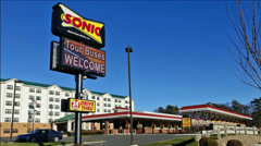 Sonic restaurant drive thru entrance Stock Footage