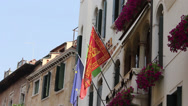 Stock Video Footage of Flags of Venice, Italy, and European Union on Building