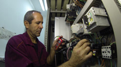 Stock Video Footage of Maintenance and Repair of the Electrical Systems.
