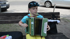 Cute boy child play with accordion squeeze-box in music day Stock Footage