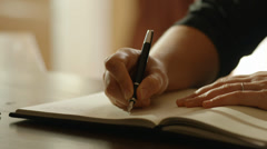 1940s era woman writing with fountain pen Stock Footage