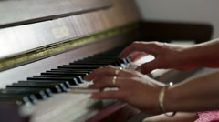 Woman hands with jewellry playing a piano Stock Footage