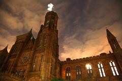 smithsonian castle night front with stars washington dc - stock photo