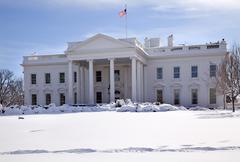 white house flag  snow pennsylvania ave washington dc - stock photo