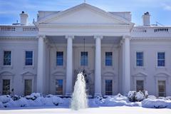 white house fountain  snow pennsylvania ave washington dc - stock photo