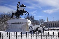 jackson statue canons lafayette park white house after snow pennsylvania ave  - stock photo