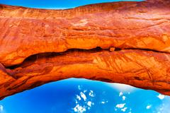 norh window arch close up blue sky rock canyon windows section arches nationa - stock photo