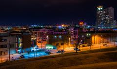 view east at night from federal hill in baltimore, maryland. - stock photo