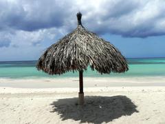 Grass umbrella on the beach Stock Photos