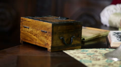 Detail of scholars table with an old shrine Stock Footage