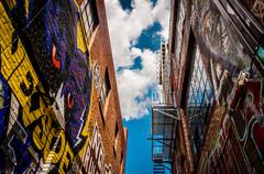 walls of old buildings in graffiti alley, baltimore, maryland. - stock photo