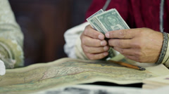 Scholar counting the bank notes Stock Footage