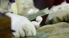 Detail of mayor hand paying for scholars service Stock Footage