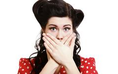 Surprised girl covering her mouth by the hands Stock Photos