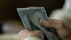 Detail of male hands amid counting the bank notes Stock Footage