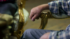Farmers with their hands on the old chairs handhold  - stock footage
