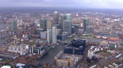 Aerial view above the towers of London's financial district, Canary Wharf Stock Footage