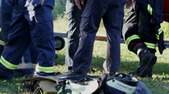Low shot of group of firemen in full gear Stock Footage