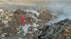 Burning garbage dump, ecological pollution. spontaneous garbage dump. - stock footage