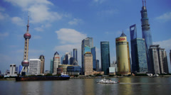 Ship sails through downtown Shanghai,Lujiazui economic Center. Stock Footage