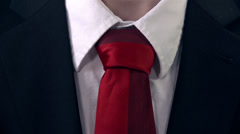 Business Man in Black Suit Untying the Red Tie Stock Footage