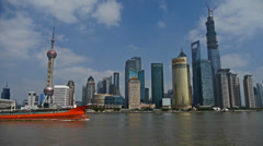 Red ship sails through downtown Shanghai,Lujiazui economic Center. Stock Footage