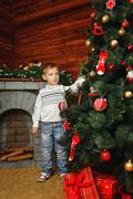 Boy, christmas tree and gifts Stock Photos